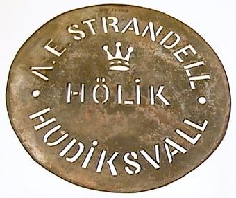 Rund metallplåt med utstansad text. Användes för märkning av tunnor eller lådor.