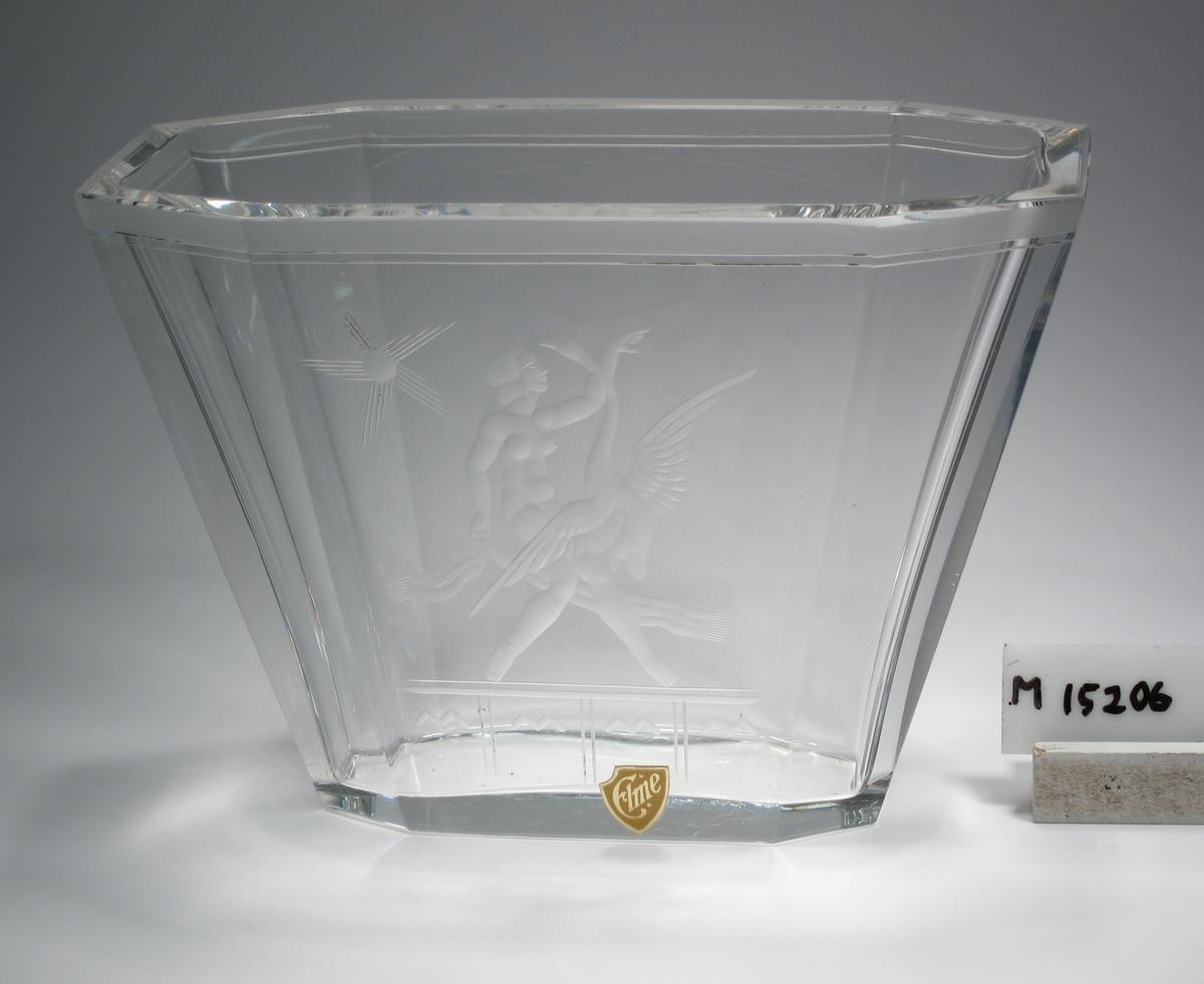 Vas. Formgiven och graverad av Emil Weidlich.* Beskrivning: I genomskärning avlång, med brutna hörn. Nedåt avsmalnande. Graverad dekor: Flicka med fågel. Färg: Ofärgat klarglas. Mått: Ovan anges mått för höjd och mynningens längd. Bottenlängd: 117 mm. Inskrivet i huvudkatalog: 1952.  C:a 50 exemplar har tillverkats 1935-40. På den tiden var priset 125-130 kr/vas. Uppgift lämnade av Emil Weidlich, Älmhult, september 1980.  * Emil Weidlich (1895-1986), f. i Böhmen, Tjeckien. Verksam på Orrefors 1920-1929, därefter Elme glasbruk.  Källa: Församlingsbok 1921-1931, Hälleberga fs, SVAR. Sveriges Dödbok 1947-2003. Funktion: Prydnadsvas