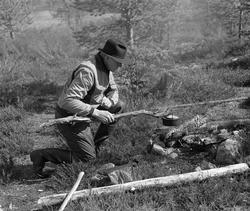 Kvilestund under fløtinga i Femundselva i Trysilvassdraget v