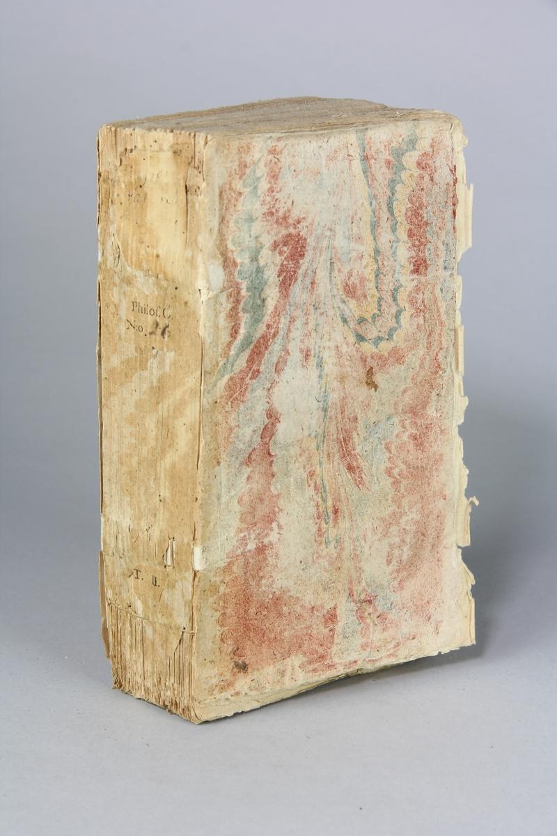 """Bok, pappband """"Histoire naturelle de l`univers"""", del 2, tryckt i Paris 1734.  Marmorerat band med blekt  och skadad rygg, påklistrade pappersetiketter med titel (oläslig)  och volymens nummer. Med skurna snitt."""
