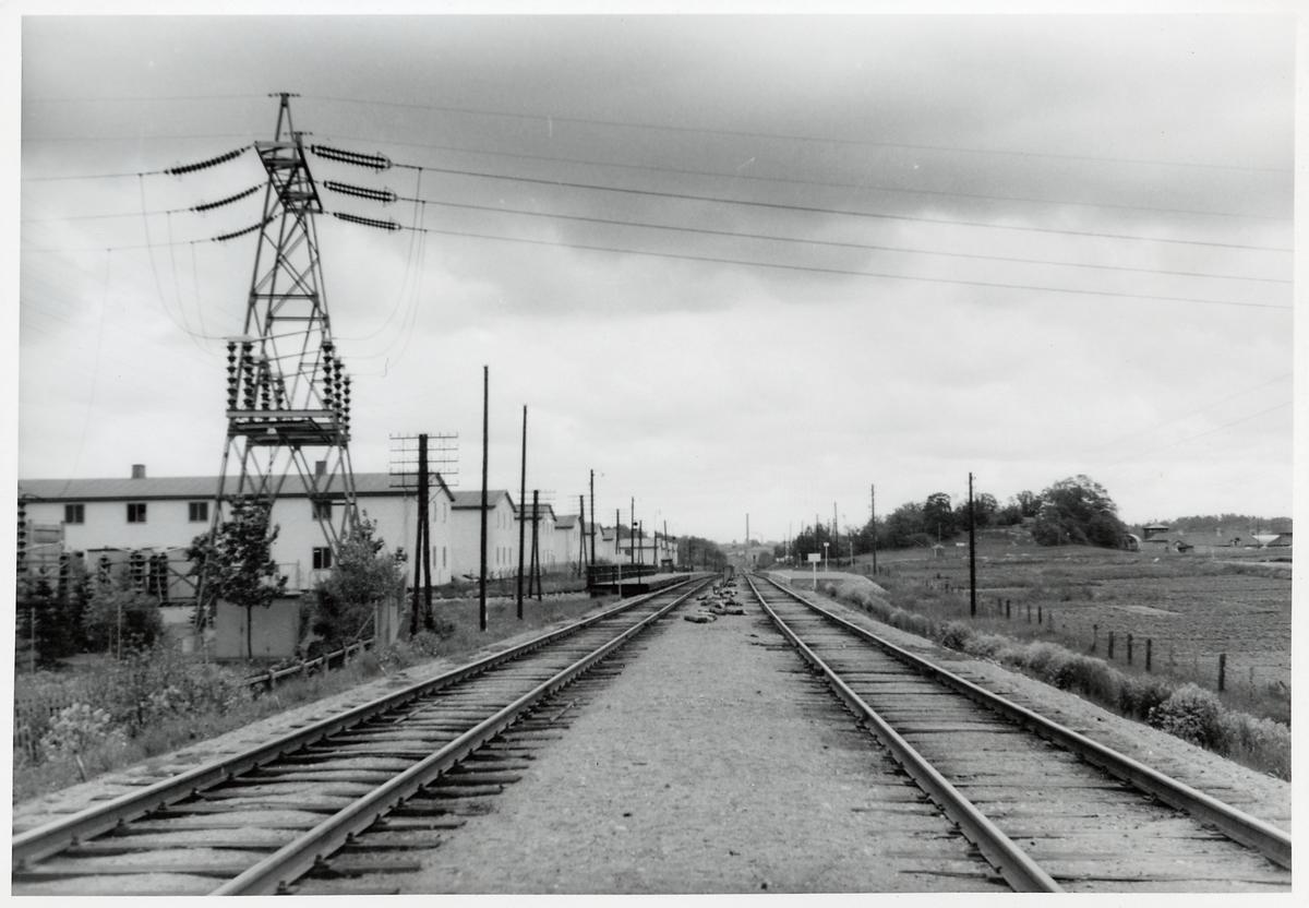 Kraftledning över järnvägen, på sträckan mellan Sundbyberg och Spånga.