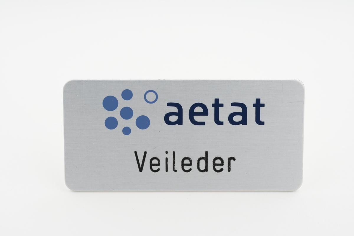 """Logo med bokstavene """"aetat"""" og sirkler"""