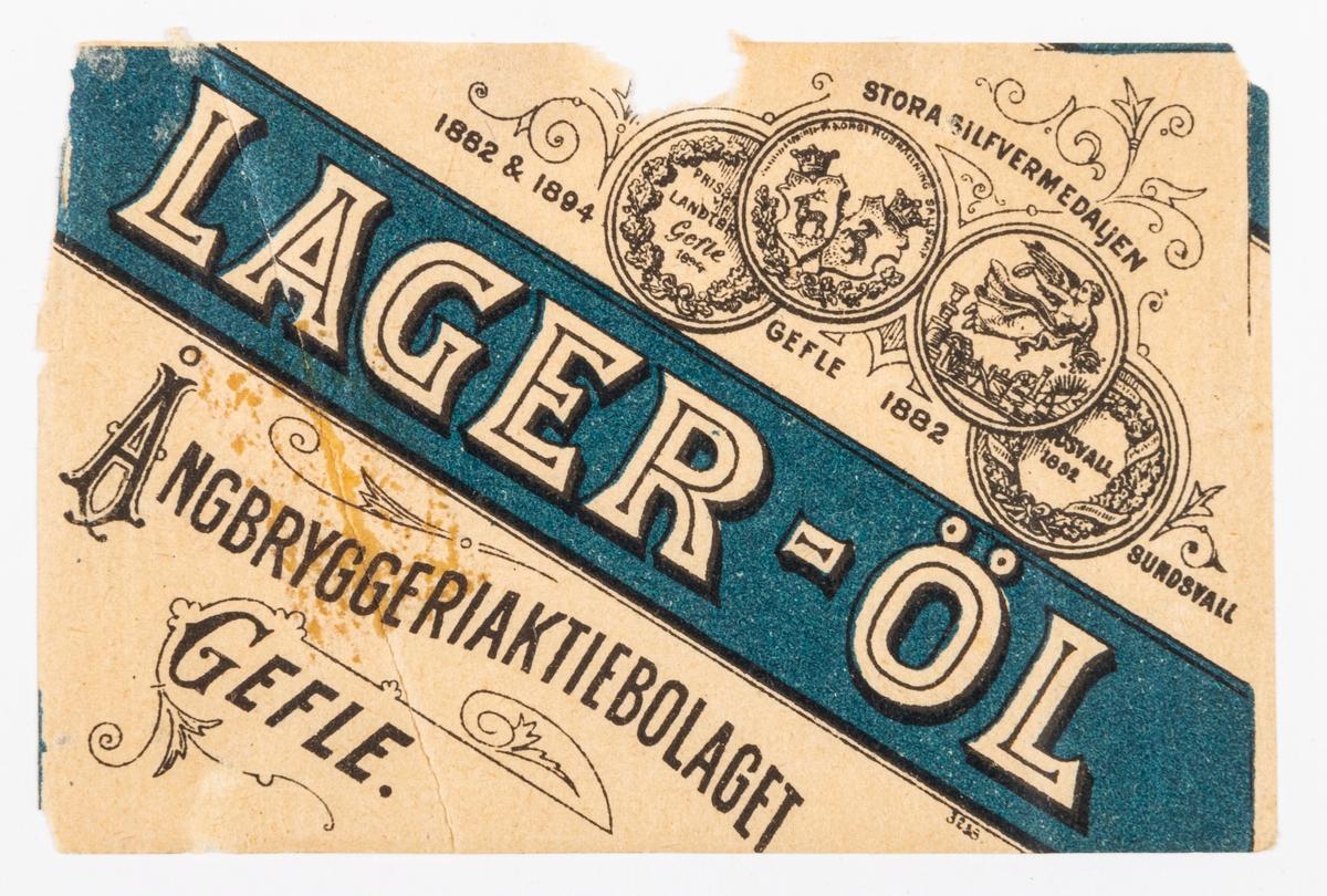 Lager-öl, Ångbryggeriaktiebolaget, Gefle. Del av samling bryggerietiketter av papper, från olika bryggerier i Gävle.