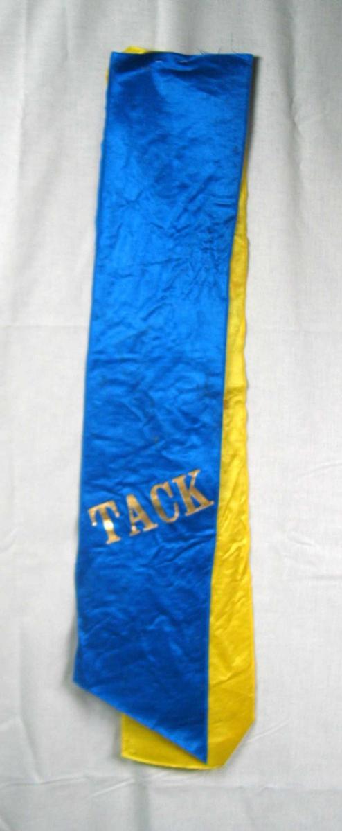 Begravelsessløyfe i blå og gul silke.