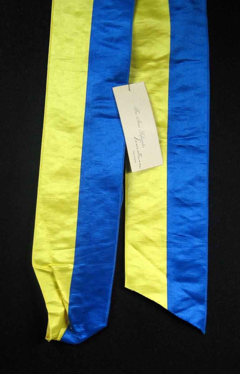 Begravelsessløyfe i blå og gul silke med visittkort.