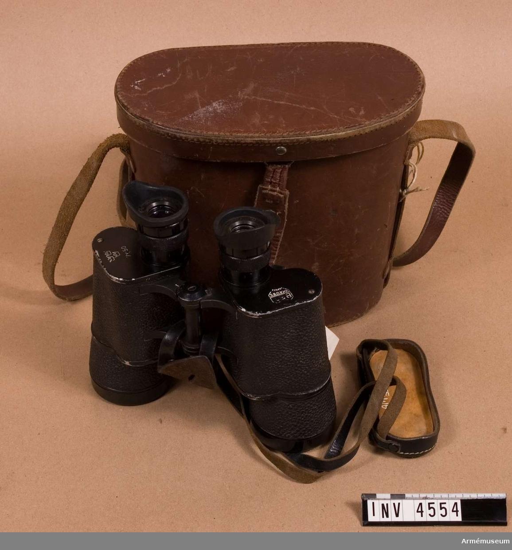 Dubbelkikare t robot.Består av: 1 kikare, 1 väska av läder.Vikten utan väska. (M 3011-181011).