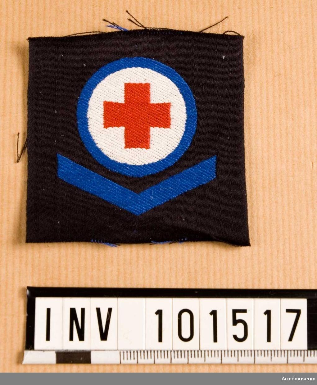 Gradbeteckning: Sjukvårdare, värnpliktig, II klassens sjöman, marinen.