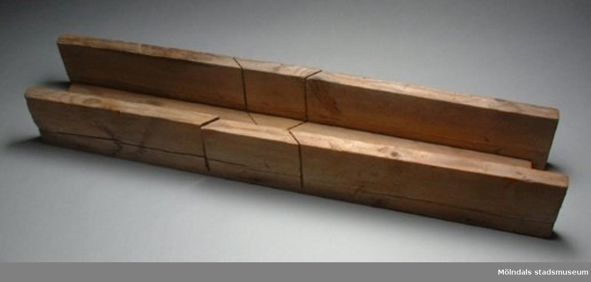 Lång geringslåda med endast två sågspår som bildar ett kryss.Sven Johansson är givarens far.