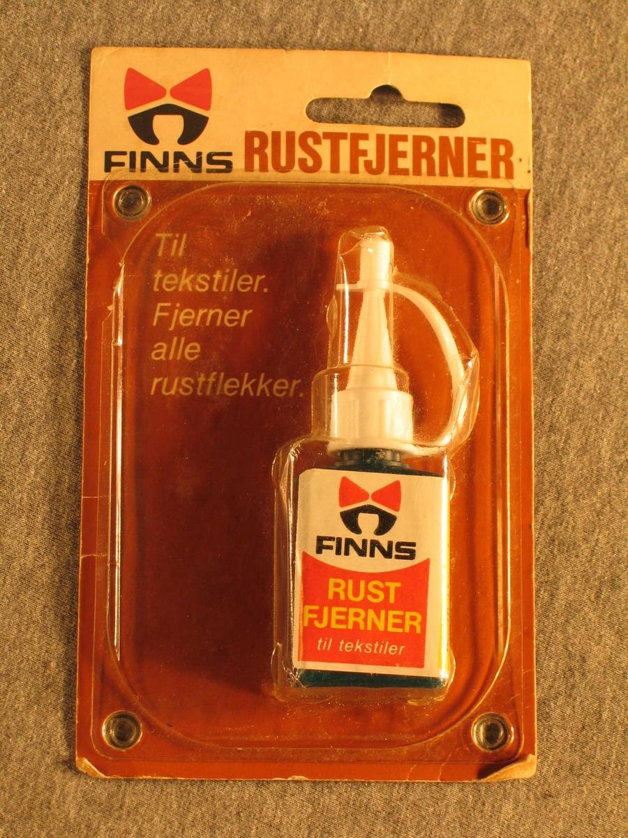 Lita flaske med rektangulært snitt. Kork med spiss og hette. Ligg i originalpakning.