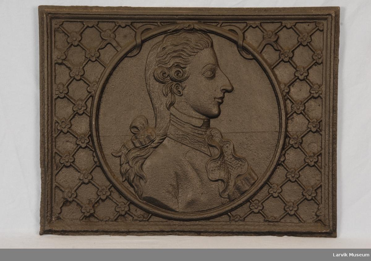 Brystbilde av Fredrik VI som kronprins i profil mot høyre, i rund medaljong. gitret bunn