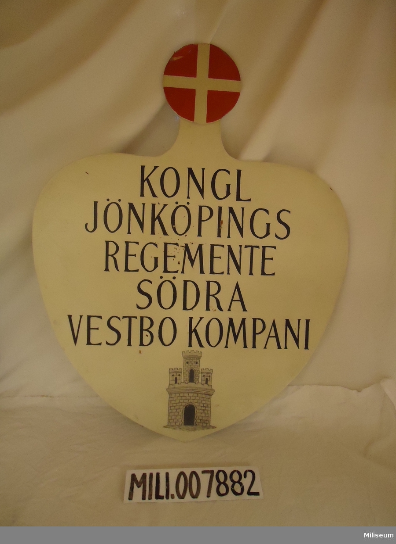 Skylt av masonite, 1920-talet. Kongl Jönköpings Regemente, Södra Vestbo kompani.