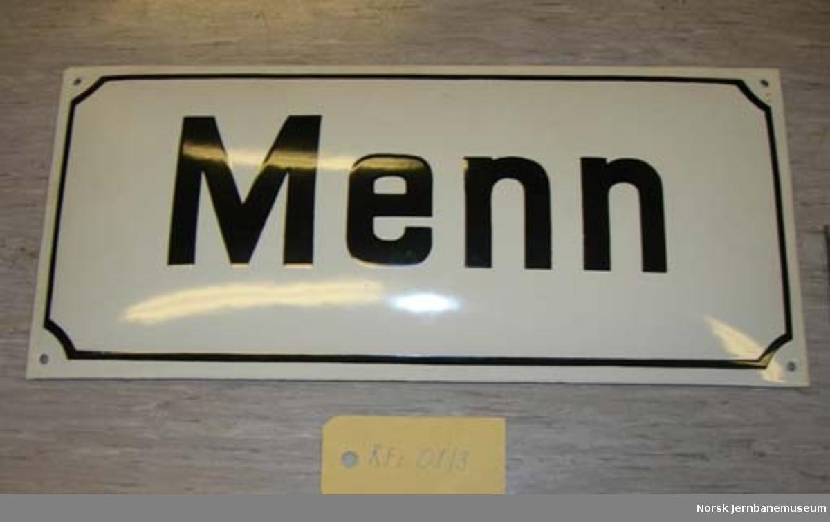 """Skilt : """"Menn"""" - til toalett på stasjon"""